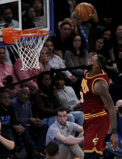 Cavaliers LeBron James leaps and dunks the basketball