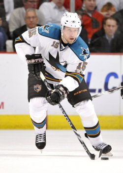 Sharks Heatley skates with puck against Blackhawks in Chicago