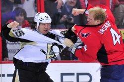 Pittsburgh Penguins' Arron Asham fights with Washington Capitals' John Erskine in Washington