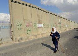 A Palestinian Walks At Qalandia Checkpoint, West Bank