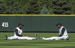Rockies Young, Jr. and Fowler Talk While Stretching in Denver