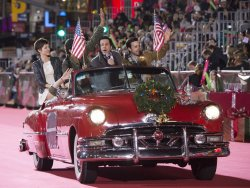 """Cast members from """"Significant Mother"""" ride in the 84th Annual Hollywood Christmas Parade in Los Angeles"""