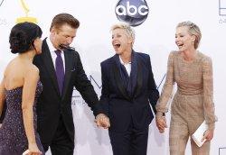 Alec Baldwin, Ellen DeGeneres and Portia de Rossi attend the 64th Primetime Emmy Awards in Los Angeles