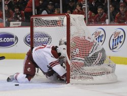 Chicago Blackhawks goalie Corey Crawford makes a save on Phoenix Coyotes Antoine Vermette in Chicago