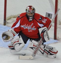 Capitals goalie Theodore blocks a shot from the Penguins in Washington