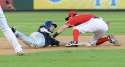 Rangers Kinsley tries to tag Rays Matt Joyce