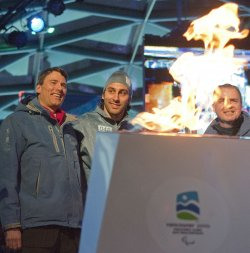 Canucks goalie Luongo carries torch during Paralympic torch relay in Vancouver