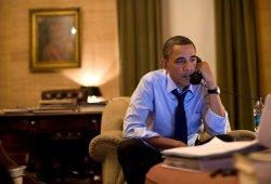 President Obama talks to Prime Minister Naoto Kan of Japan in Washington