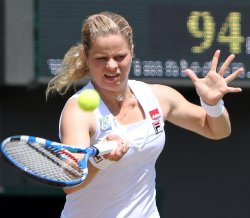 Kim Clijsters plays a forehand at the Wimbledon Championships