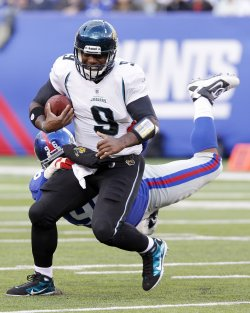 New York Giants Barry Cofield grabs on to Jacksonville Jaguars quarterback David Garrard at New Meadowlands Stadium in New Jersey