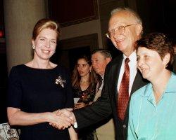 Queen Noor of Jordan greets son of former Russian leader Nikita Khrushchev