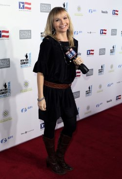 Anne Craig stands on the red carpet at the Stand Up For Heros Event at the Beacon Theatre in New York