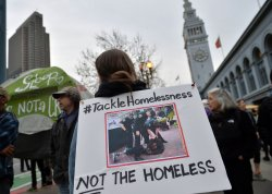 Homless Suppoerts Protest at Super Bowl 50