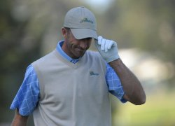Geoff Ogilvy acknowledges the gallery during the second round of the 2009 Presidents Cup in San Francisco