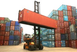 A shipping container lift crane delivers a container in Tianjin's port in China