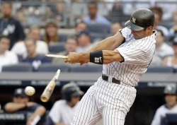 New York Yankees Jorge Posada breaks his bat at Yankee Stadium in New York