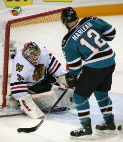 Chicago Blackhawks goalie Antti Niemi rejects a shot by San Jose Sharks Patrick Marleau in San Jose, California