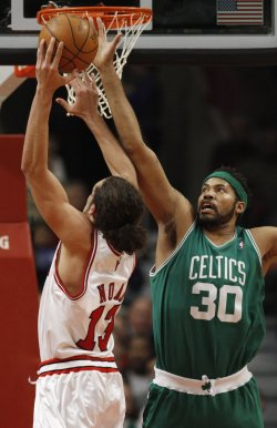 Bulls' Noah shoots over Celtics Wallace in Chicago