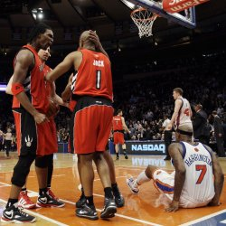 Toronto Raptors Chris Bosh (4), Jarrett Jack (1) and Antoine Wright react at Madison Square Garden