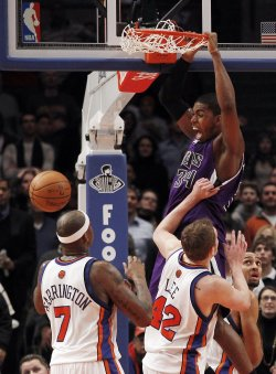 Sacramento Kings Jason Thompson sinks a game tying dunk over New York Knicks Al Harrington and David Lee at Madison Square Garden
