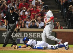 Cardinals Lance Berkman scores during game 3 of the World Series in Texas