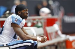 Tennessee Titans Wide Receiver Randy Moss Shows his Frustration as he Watches the Game From the Bench at Reliant Stadium in Houston