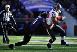 Texans' Arian Foster is stopped for a loss in Baltimore