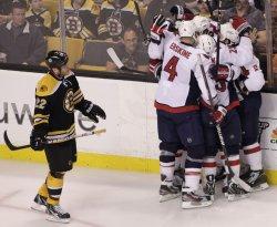 Captials celebrate goal against Bruins at TD Garden in Boston, MA.