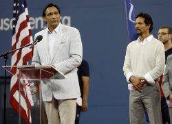 Benjamin Bratt watches Jimmy Smits speak during a tribute to tennis great Pancho Gonzales on day 6 at the US Open Tennis Championships in New York