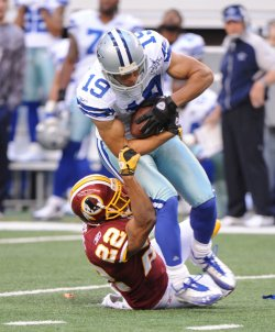 Dallas Cowboys Miles Austin gets wrapped up by Washington Redskins Carlos Rogers