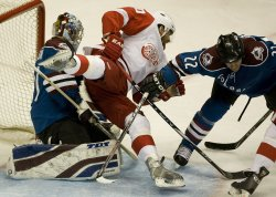 Red Wings Zetterberg Trips Over Avalanche Goalie Anderson in Denver