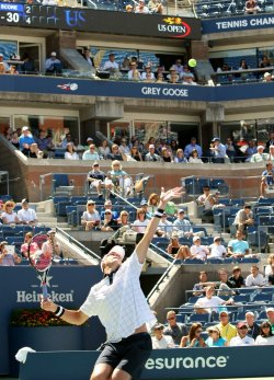 John Isner takes on Xavier Malisse in first-round action at the U.S. Open in New York