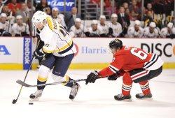 Blackhawks' Frolik Tries to Steal Puck from Predators' Radulov in Chicago