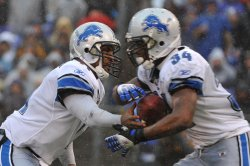Lions' quarterback Daunte Culpepper hands off to Kevin Smith in Baltimore