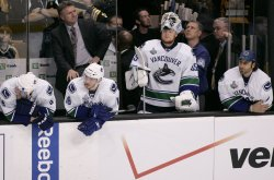 Canucks bench reacts to loss against Bruins in game 6 of the NHL Stanley Cup Finals in Boston, MA.