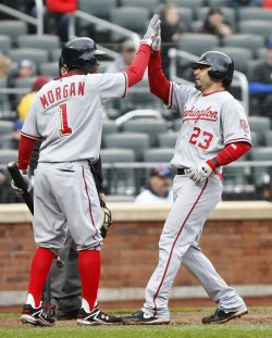 Washington Nationals Nyjer Morgan slaps hands with Wil Nieves at Citi Field in New York