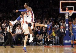 New York Knicks J.R. Smith and Steve Novak react at Madison Square Garden in New York
