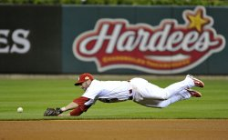 Cardinals Nick Punto dives for a ball during game 6 of the World Series in St. Louis
