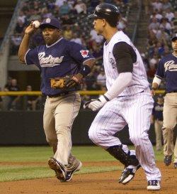 Padres Tejada Catches Rockies Gonzalez in rundown in Denver