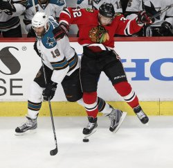Blackhawks Versteeg and Sharks Thornton go for puck in Chicago