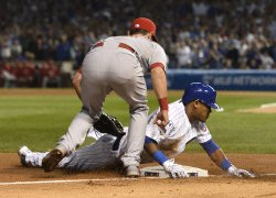 Cubs' Addison Russell slides into third in the NLDS in Chicago