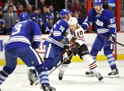 Maple Leafs Gunnarsson Knocks Blackhawks Sharp Off Puck in Chicago