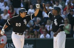 Chicago White Sox's Dewayne Wise high-fives Carlos Quentin after Quentin homered against the Boston Red Sox in Chicago