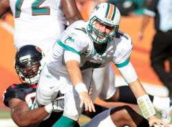 Dolphins Chad Henne falls in Miami.