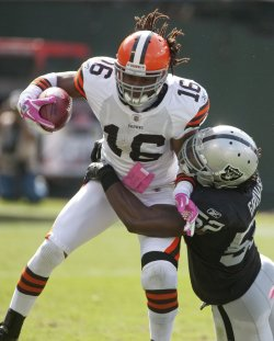Raiders Quentin Groves tackles Browns Joshua Cribbs in Oakland, California