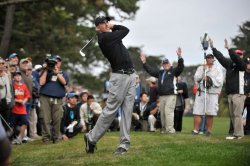 Geoff Ogilvy watches his hit during the first round of the 2009 Presidents Cup in San Francisco