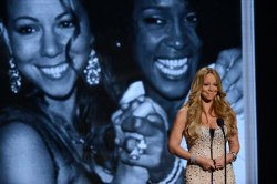 Mariah Carey participates in a tribute to Whitney Houston during BET Awards 12 in Los Angeles