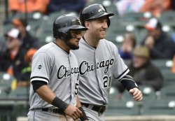 White Sox runners Melky Cabrera and Todd Frazier score against the Orioles