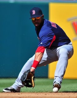 Red Sox shortstop Mike Aviles fields a ground ball in Washington