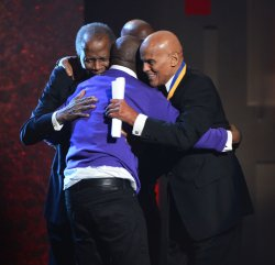 Wyclef Jean, Sidney Poitier, Harry Belafonte Common embrace onstage at the 44th NAACP Image Awards in Los Angeles